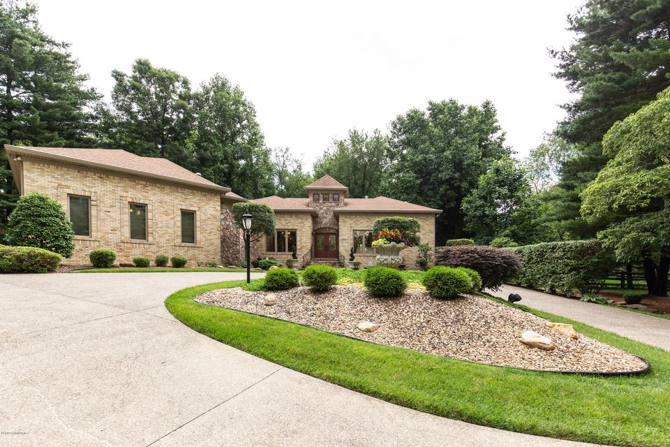 A Stunning Custom-Built Brick and Stone Home on an ideal setting in Popular Anchorage.  If you are looking for a Beautiful Home Inside and Out...this one's for you.  Undeniable curb appeal with Meticulous landscaping & large circular driveway.  This Home comes complete with views of neighboring horse property.  Truly Kentucky! Two story entry...