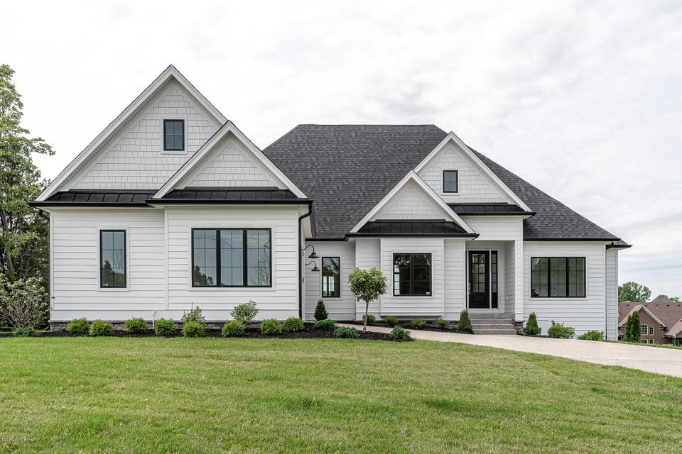 The beautiful exterior of this house will catch your eye, but the interior will make you want to call this house, ''Home.'' This custom-built, open floor plan home sits in a nice, quiet cul-de-sac. This house is a desirable ranch with a walkout basement on a half-acre lot. No expense spared when you enter the front door. There are 13 foot ceilings in the entryway, family room, and on the beautiful no maintenance deck with dual fireplace. Enjoy cooking in your kitchen with an oversized island, farmhouse sink, top-end appliances, high-end countertops, pantry, and plenty of all wood cabinets reaching all the way to the ceiling. The owner's suite has a vaulted ceiling, free standing tub, custom shower, and a built-in bench in the closet. The other two oversized bedrooms share a Jack and Jill