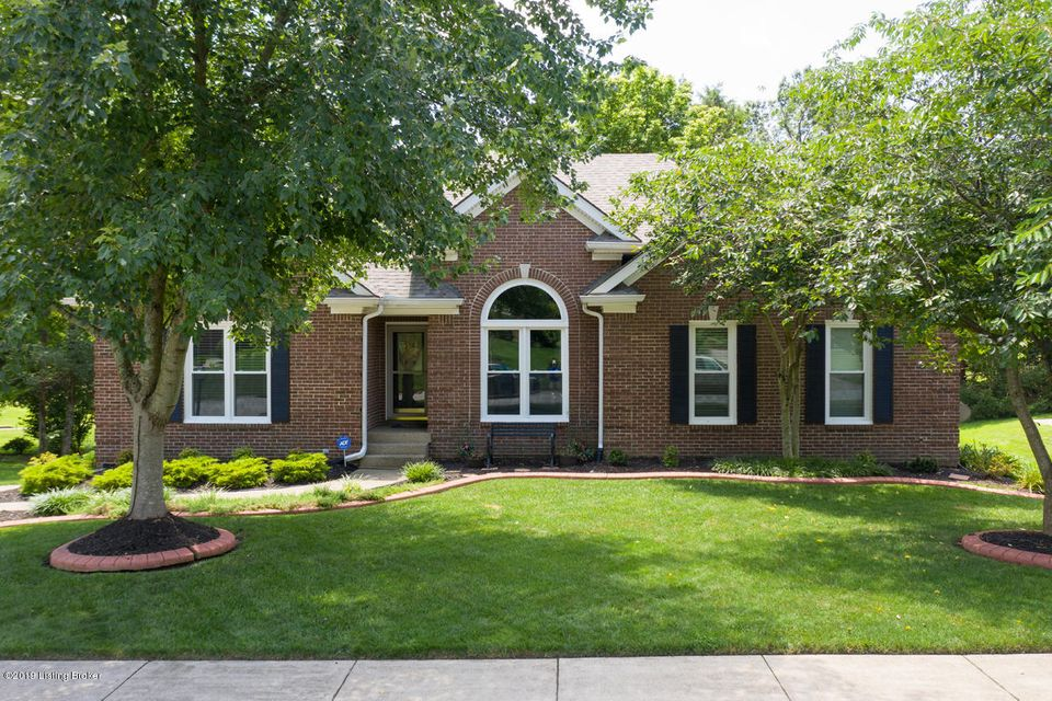 This remarkably maintained and landscaped 3 bedroom 3.5 bathroom all brick walkout ranch is sitting on the 3rd hole of Polo Fields golf course. The main level includes hardwood floors in the living room, kitchen, dining room, and master bedroom. The living room has a fireplace, built-ins, and door leading out to the tremendous deck. The eat...