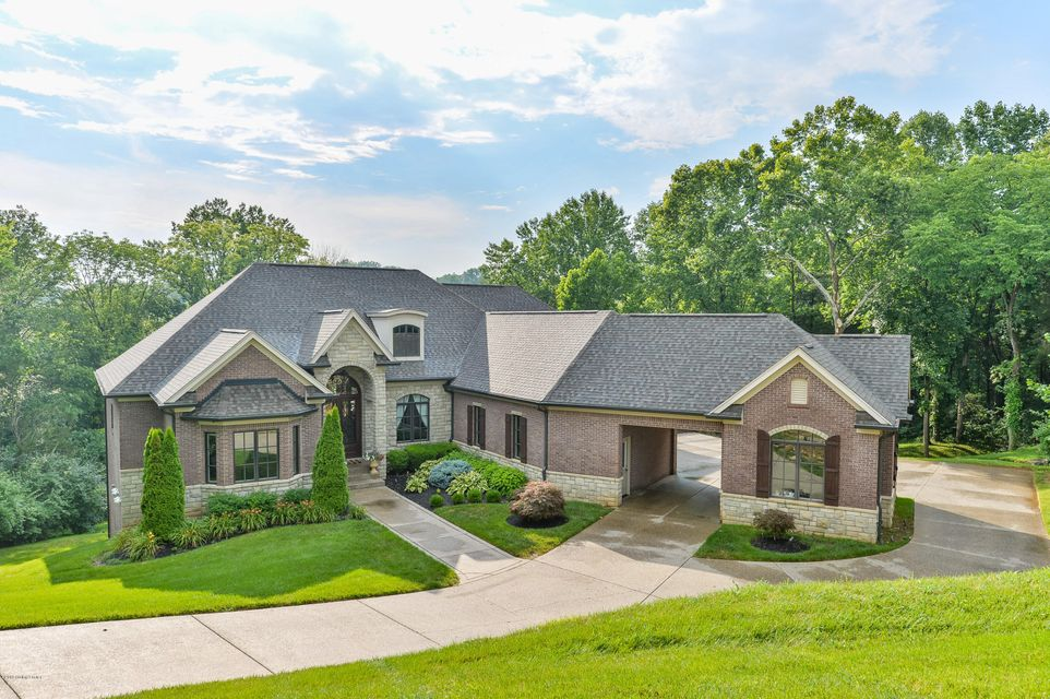 This elegant Nevel Meade walkout ranch is nestled in a picturesque woodlands setting with outstanding views of nature from every vantage point. Ideally situated on over 4 acres in North Oldham County, the current owners recently had a professional arborist grade and clear the land, which now offers the most phenomenal view of Harrods Creek...