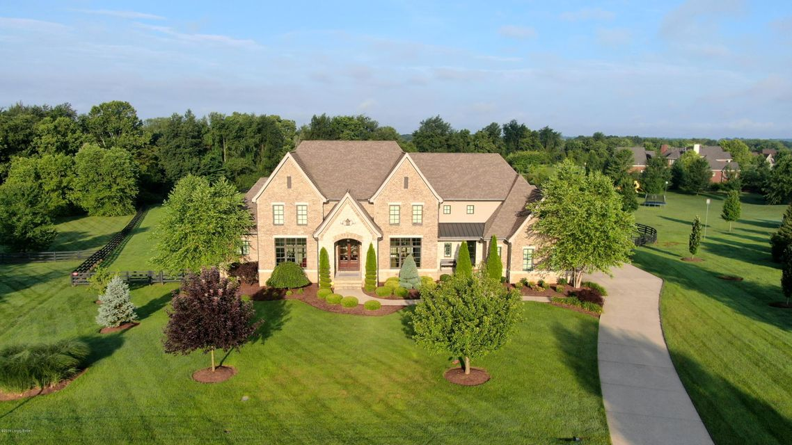 Situated on a breathtaking lot of Oldham County countryside, this incredible custom-built home offers a glamorous everyday getaway, featuring 3.3 manicured acres, iconic four-board fencing and resort inspired outdoor living spaces including freeform pool, second floor terrace and spacious patio with covered dining area, built-in grill and...