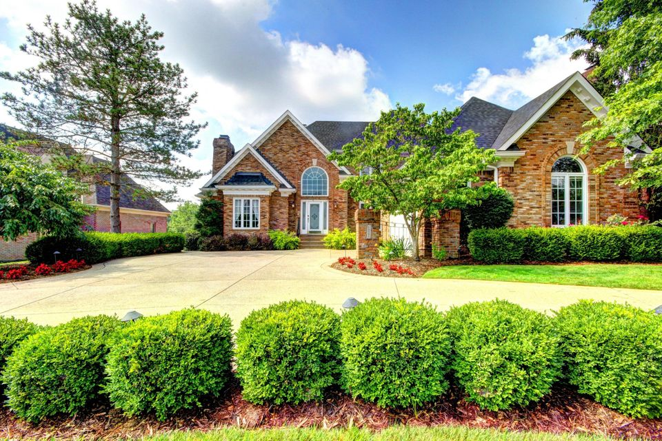 This beautiful brick SMART-HOME with circular driveway, being sold below appraised value, rests above one of the sparkling blue lakes of Lake Forest with a view of the fairway. Living at 14706 Forest Oaks Drive places you at one of the most beautiful settings in the entire subdivision. On the opposite side of the lake is a lush cover of trees...