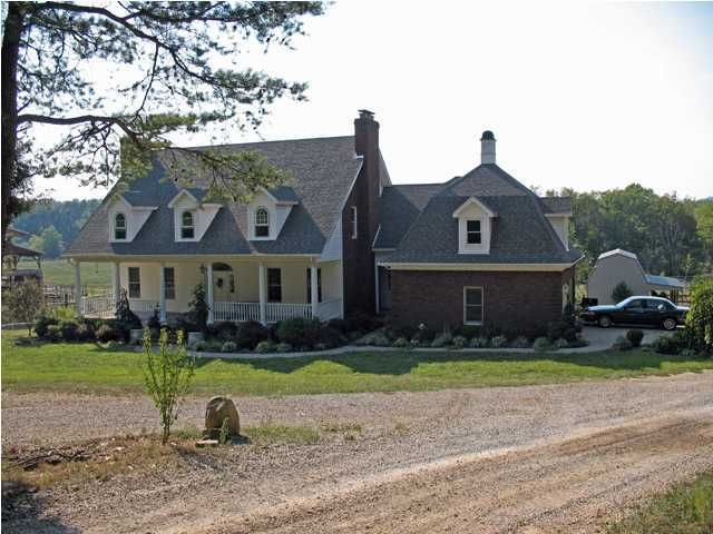 Wonderful 120 acre horse farm in Bullitt County. Custom 21 year old home includes: 1st floor master suite, living room, dining room, library office with fireplace, eat-in kitchen/dining area (area opening onto deck overlooking pastures). 2nd floor has 2 bedrooms with shared bath, guest bedroom with private bath, two additional rooms which could be bedrooms or offices, large unfinished basement has massive brick fireplace with room to cook dinner. A security system is included. Home has a 2 gas log/wood fireplaces, electric heat with propane backup, and cistern water. The 120 acres includes approximately 20 acres of hayfield, 10 acres divided into pastures, small orchard, a large lake, 3 barns, and a hay shed.