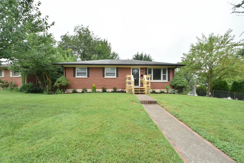 Welcome to 2113 Carla Court. This all brick walkout ranch is situated on a beautiful corner lot in Thoroughbred Acres. You'll enjoy mature trees, fresh landscaping, and a huge fully fenced backyard. A nice front porch greets you as you walk up to this home. Heading inside will bring you into the spacious formal living room. You'll immediately notice the hardwood floors and abundance of natural light. Behind the living room is the eat-in kitchen and stairs to the basement. Down the hall are the bedrooms, all with hardwood floors, and a full bath. Downstairs is a great partially finished basement. There is a huge family room with free standing wood burning fireplace, full bath, and large unfinished laundry and storage area. Heading outside from the basement brings onto the patio.