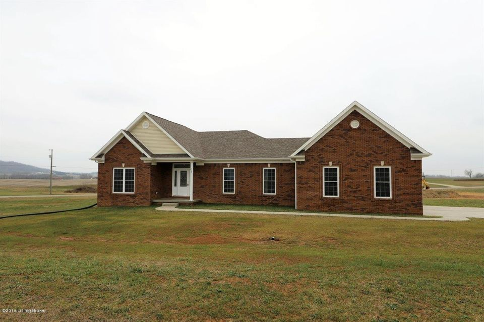 Fall in love with this stylish new construction home that is beautifully nestled on a large 1.38 acre corner lot!  As you enter the home you will find vaulted ceilings in the great room & dining area, and 9 ft. ceilings throughout the main level.  The spacious great room features laminate flooring and a gas log fireplace.  The kitchen is fully equipped with an island, beautiful white cabinets, granite counter tops, a stainless appliance package and tile flooring.  The master suite has a trey ceiling, a large walk in closet, a double sink granite top vanity, garden tub and a separate stand up shower.  This home has a desirable split bedroom floor plan.  The walk up basement has a finished 3rd full bathroom and plenty of space to finish in the future, or an abundance of storage.  This home