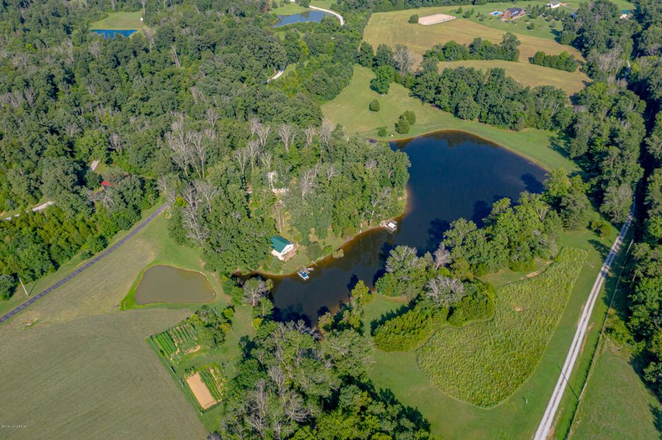BE SURE TO CHECKOUT ALL OF THE PICTURES AND VIDEO!  Unique opportunity awaits you on this 21+ acre PARK LIKE PROPERTY. Which includes a breathtaking 6-acre lake & pond. There are 2 custom built homes, 2 boat docks & 2 large outbuildings. FORGET THE MOTHER IN LAW'S SUITE, SHE CAN HAVE HER OWN HOME!!! Property is also ideal for bed and breakfast,...