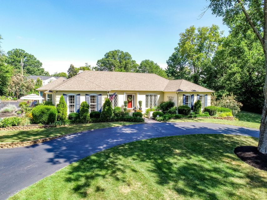 Rare opportunity to live in one of the best locations in Louisville! This spacious Walk-Out Ranch Home with 4 CAR GARAGE has been beautifully UPDATED & sits on almost 1 ACRE in the desirable Indian Hills! Special features include UPDATED Kitchen, 5 Bedrooms, 4 Full & 2 Half Baths, ALL UPDATED, beautiful hardwood floors throughout most of the...
