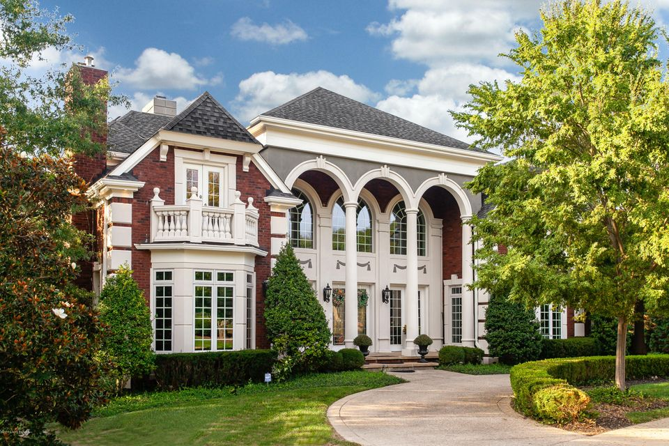 Voted Louisville's Most Prestigious Home by The Voice Magazine! Situated on a remarkable 1.3 acres, this exquisite home boasts over 10,000 square feet of luxurious living space. The luxurious 6 bedroom, 7 bath estate complete with elaborate woodwork, coiffured ceilings, custom mouldings, ornate doors with heavy brass fixtures and crystal knobs....