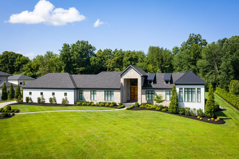 This masterpiece of modernism rests on a 2 acre lot in North Oldham County's prestigious River Glades neighborhood. The sleek yet stately ranch style home is a showcase of expansive spaces, open floor plans and walls of glass to create an awe-inspiring experience. This one year old home is ideal for indoor and outdoor entertaining, including...