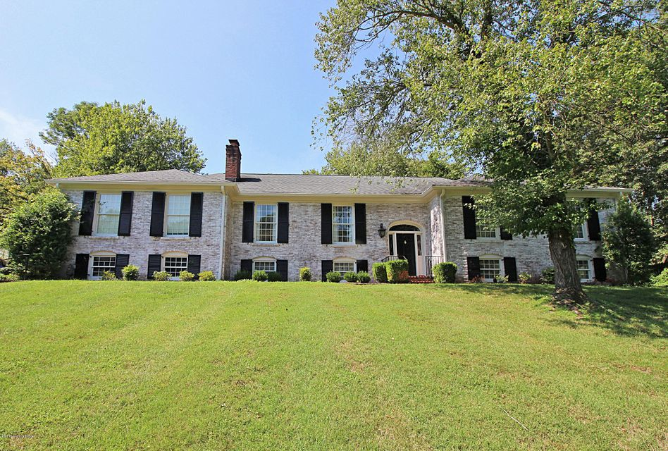Fantastic remodeled home in the heart of the sought-after Country Club section of Indian Hills. The main level features hardwood floors and professionally remodeled kitchen - the heart of the home - with white and glass cabinetry and a 9-foot long center island . The island and countertops are a grey/blue honed marble, protected with a high-grade...