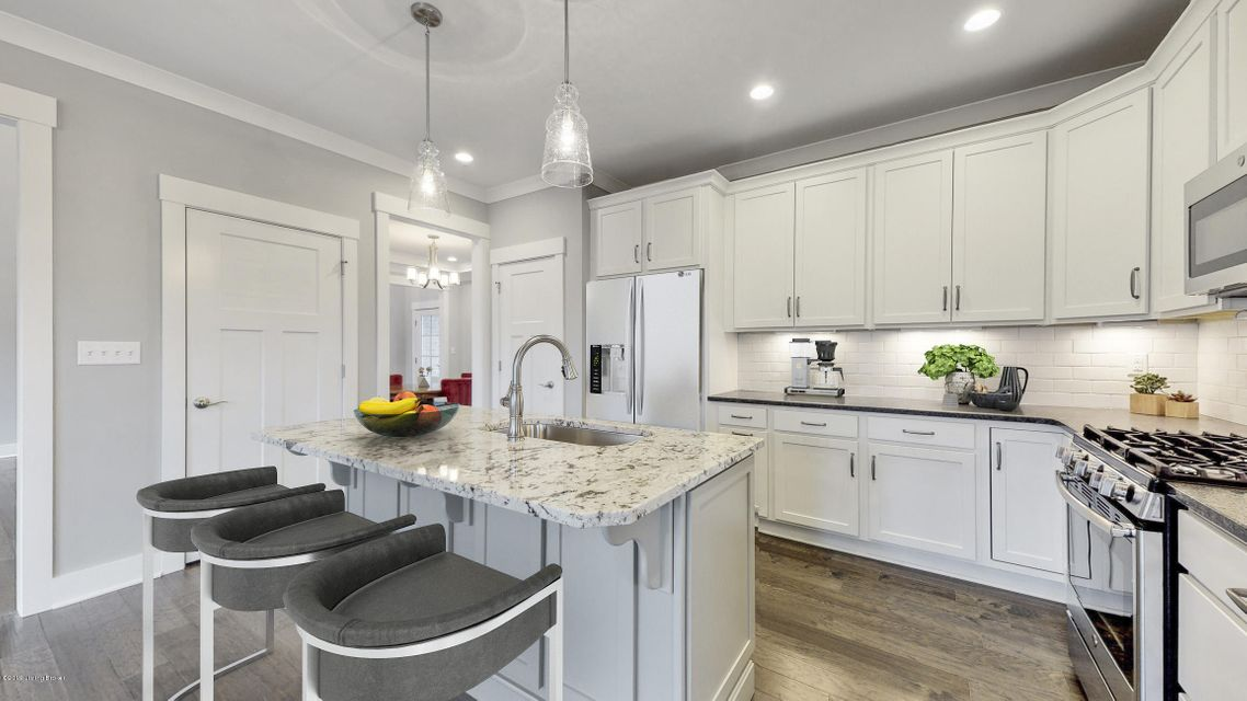 Welcome to this beautiful custom home in the fabulous subdivision of Rock Springs! You'll love the eat-in kitchen with gas cooktop, lots of cabinets and center island--all open to the great room with fireplace. Bonus....there's also a formal dining room! Right off the 2-car garage you'll find convenient cubbies for storage. The gorgeous owner's suite has a spacious private bath with tub, shower, double-bowl vanity and a large walk-in closet. Three additional bedrooms complete this home, along with a covered back patio. Don't miss out on this wonderful home under $500K!