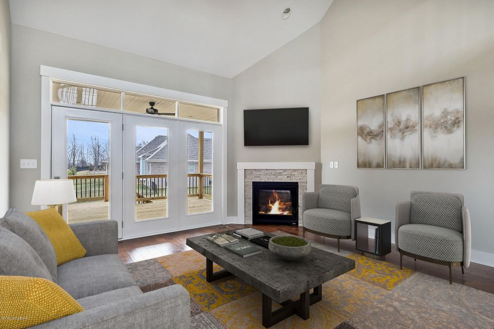 Gorgeous brick/stone 1.5-story walkout home with 4 bedrooms, 3.5 baths and over 3,300 SF of living space. High-end finishes such as hardwood, ceramic tile, detailed trim work, granite counters and more. The eat-in kitchen is a chef's dream...with custom cabinetry and a center island with seating, all adjacent to the great room with cozy fireplace. Two additional bedrooms and a shared bath finish the upper level. The finished walk-out lower level overs a rec room, bath and a bedroom with an egress window. Two HVAC units are an added bonus in this stunning home.