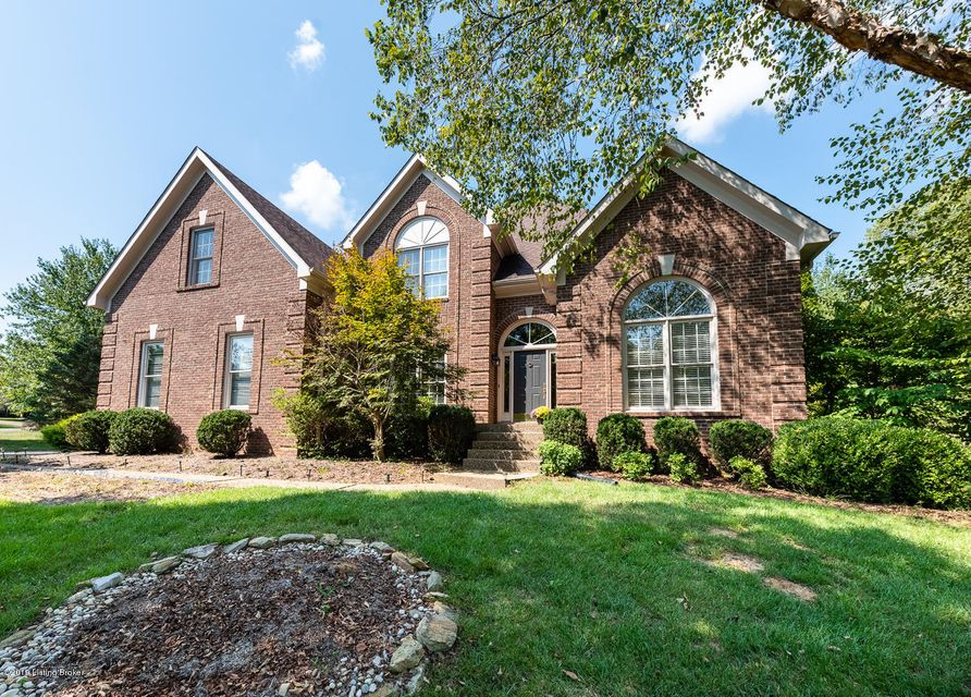 Enjoy the Estate section of Hunting Creek in this beautiful home that sits on just under a 1/2 acre private lot. This home features soaring ceilings in the two story great room with brick fireplace. The main floor has hardwood floors through the main areas. The formal dining room is just off the front entry and across from the private sitting...