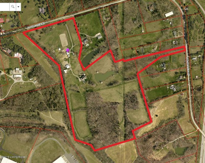 70 acres in prime location for Residential Development.  R4 zoning, 2 miles from Bluegrass Business Park.  Land is rolling with 2 access points on S. Pope Lick Rd.  City Water, Sewer Connection at rear of property.  Property is currently a horse farm, with 9,935 sqft house.