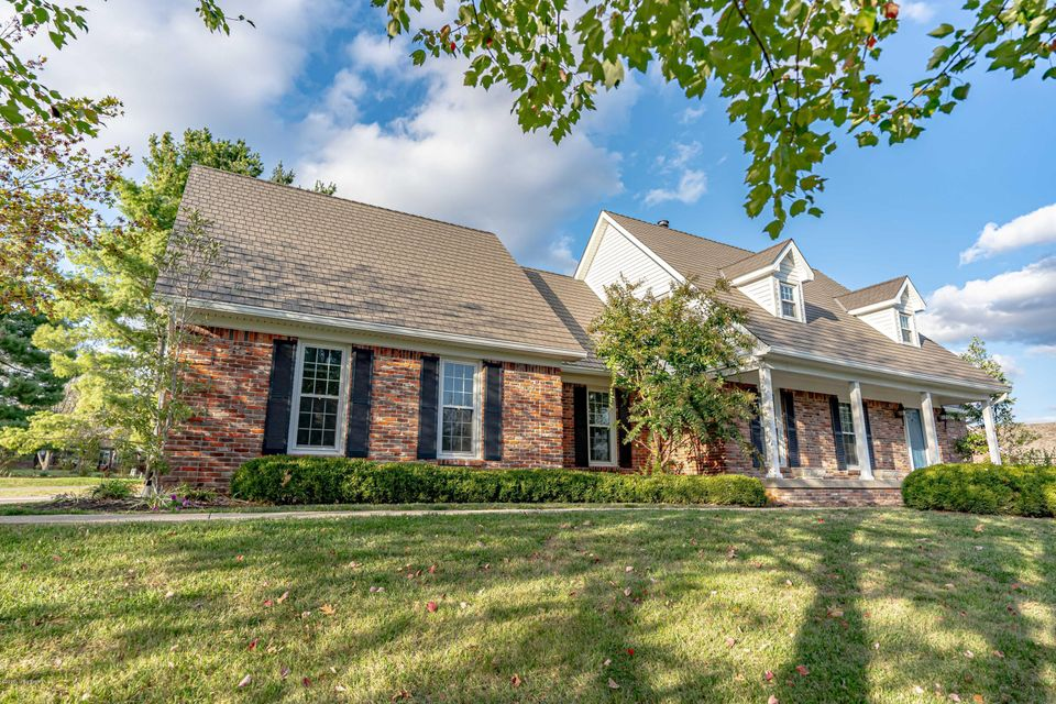 Beautiful home that sits stately on hole 12 of the Shelbyville Country Club.  This home has been updated to prime fashion starting with a brand new life time warranty roof, the kitchen has been updated with granite counter tops stainless steel appliances, the flooring on the first level is all refinished hardwood.  The master suite is large with a walk in shower, tub, and double vanity along with walk in closet.  Family room is equipped with a gas log fireplace and plenty of room to entertain.  The upstairs has 3 more large bedrooms and full bath and the basement has a finished family room, full bath and wet bar.  This home has it all and is in one of the premier neighborhoods in Shelby County.
