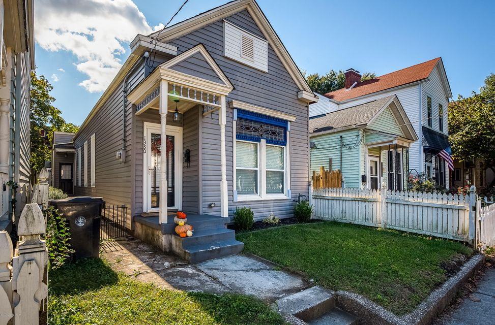 Renovated, charming, a perfect place to call home for the holidays. This warm and cozy 2 bedroom modified shotgun (2 real bedrooms) has it all! Open floor plan for entertaining, original refinished hardwood floors, tons of closet space for storage, fenced back yard with new covered deck and more!