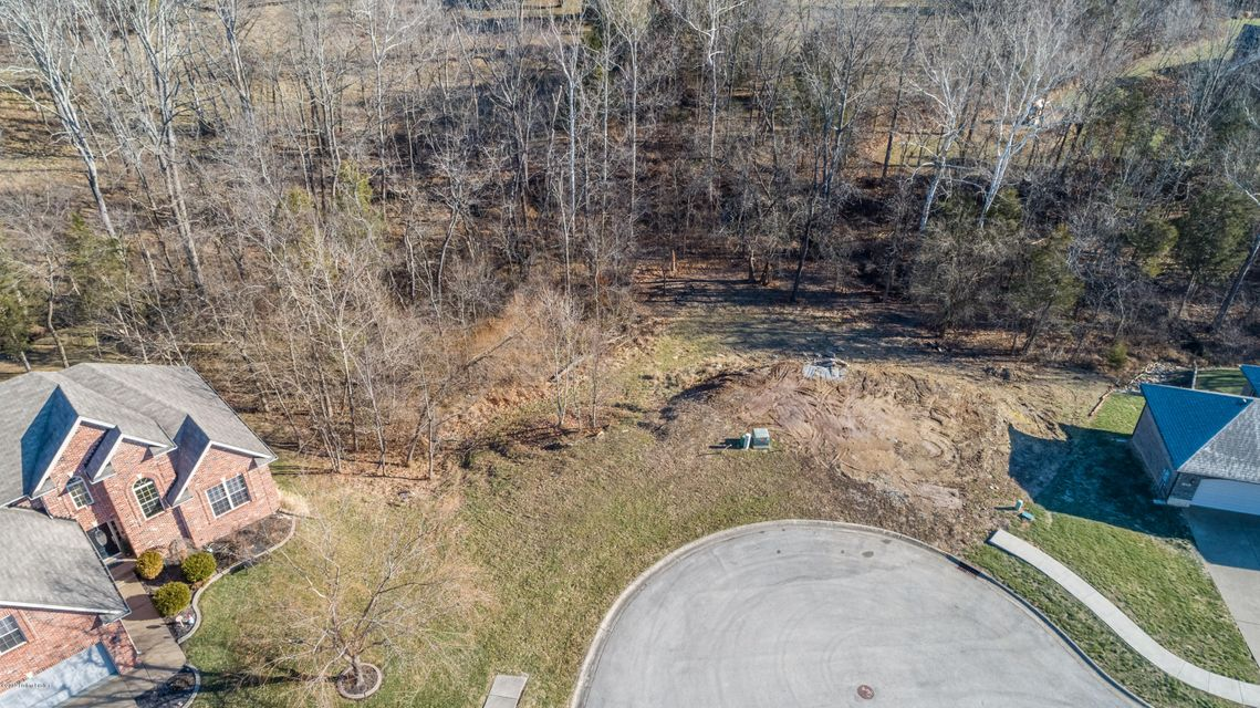 Situated the end of the private cul-de-sac, this beautiful walkout lot is one of the last building lots available in The Polo Fields.  Featuring a wooded & private setting, a quiet creek and a very speacial location in The Polo Fields neighborhood. The lot is ready for you to build your new home.
