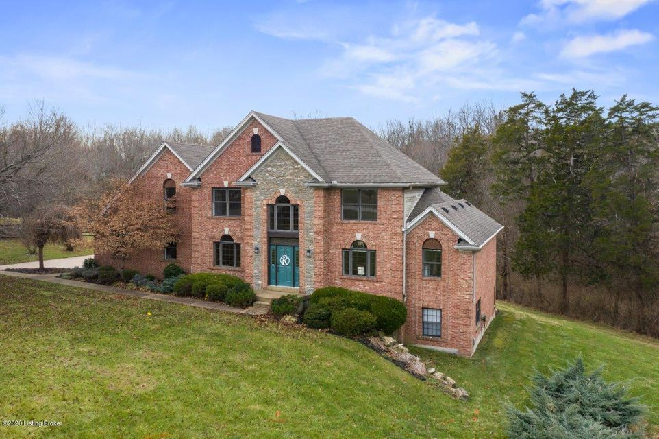 Welcome to this custom built two-story brick home in the fabulous neighborhood of Derbyshire! This property stretches over 4.9 acres, 3/4 of which is wooded with ample wildlife and a picturesque creek flowing through it. The country setting provides ideal privacy while remaining only 10 minutes from Middletown and 25 minutes from downtown, giving the owner the best of both worlds. Some of the key features of this property include: a custom fire protection sprinkler system; new paint and carpet on the first and second floors; Pella windows; Fiber Optic Internet; air compressor lines in basement workshop and garage; and a HUGE Pole Barn with an ''oil changing pit'' and a sliding fall chain hoist.