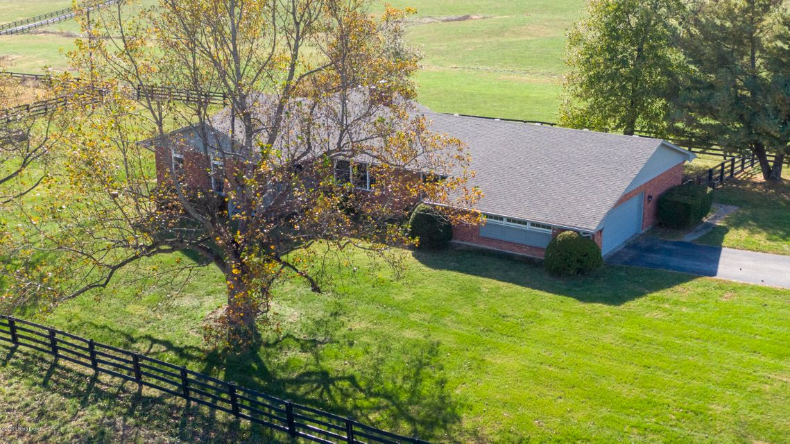 BY APPOINTMENT ONLY. Approx 54  acres (subject to survey) plus a 5 BR, 3 BTH, 2300 sqft brick ranch with a 2 car garage IN OLDHAM COUNTY! Beautifully rolling land with black board fencing. The brick ranch  features two living areas (one with a brick fireplace), a formal dining room, eat-in kitchen, separate laundry room, Master Bedroom and...