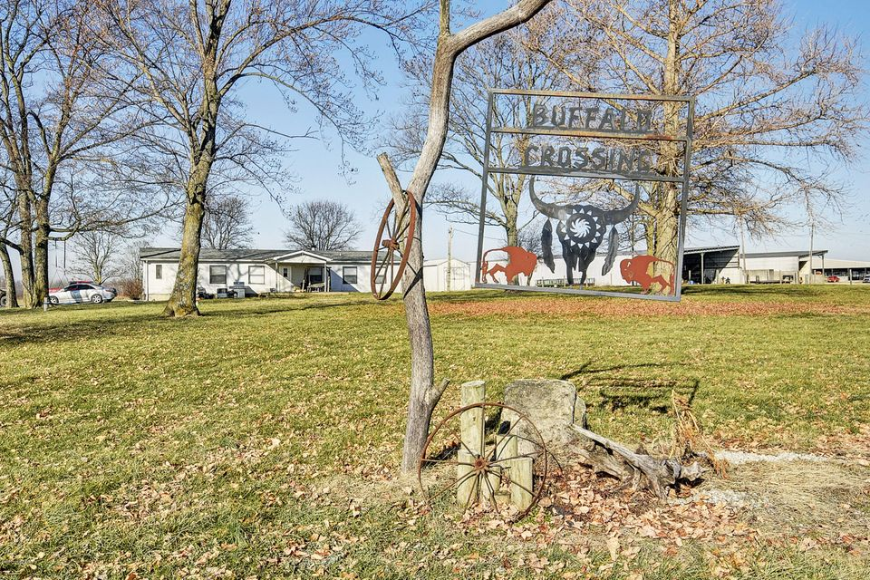 Rare opportunity to own a turn-key cattle/buffalo livestock operation in Shelbyville, KY! Approximately 285 acres and well designed and beautifully fenced! This property includes ranch, multiple feed lots, 2 lakes, 3 ponds, 7 outbuildings (including several feed barns), equipment building, indoor working facility with 6 pens and squeeze shut),...