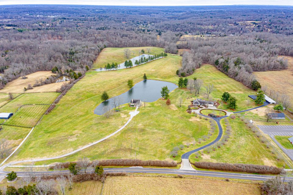 DEVELOPMENT POTENTIAL! 53.59 +/- Acres (price per acre: $83,970) - Zoned R-4 - Currently allows 4.84 units per acre. Property features 2 stocked lakes (2.0 acres & 2.5 acres, 25ft & 36ft deep). Excellent topography - suitable for Residential Development. Easy Access to I-265 and I-64 & minutes away from shopping, restaurants, Parklands of Floyds Fork, Valhalla Golf Club, Bluegrass Industrial Park, & more. In the Path of Sewer Expansion. Parcel #1; consists of 5.0800 acres of R-4, this parcel includes a single family residence w/2 car garage (5,097 total SF), barn w/ separate geothermal HVAC/electrical/bath (1,393 SF), shed (770 SF) & three-sided shed (2,758 SF) originally constructed in 1957. Parcel #2; consists of 48.5088 Acres of R-4 land, this parcel includes a single family residence