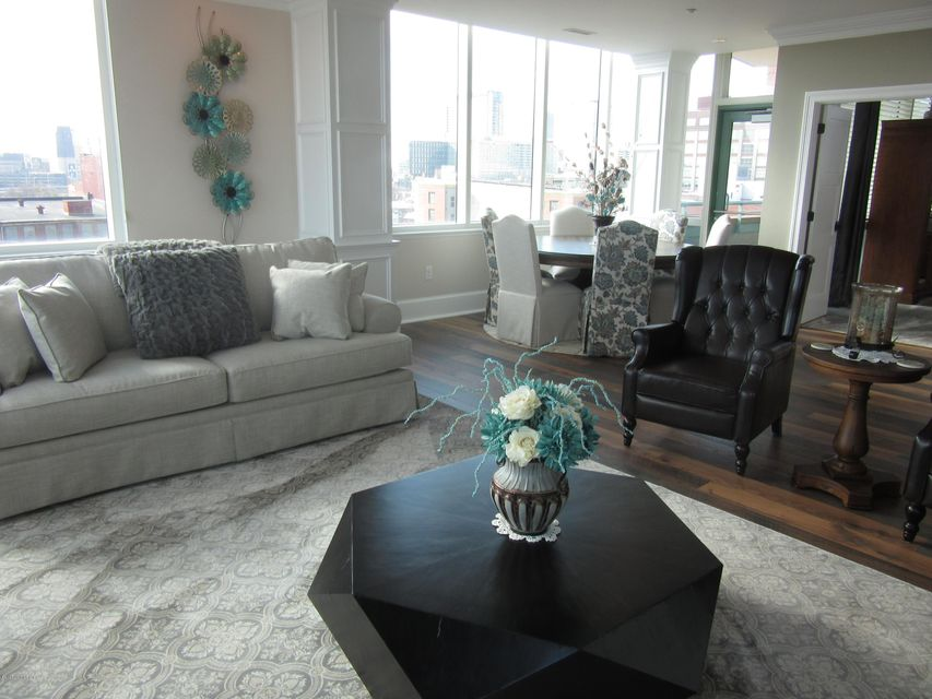 Gorgeous, open floor plan, immaculate, breath taking views all define this elegant must see Waterfront Park Place Condominium.  Unit 804 offers privacy and as you enter you will be amazed at the beautiful space this home offers for entertaining friends and family.  This home features a beautiful updated kitchen with granite and marble counters, an island that seats 3-4, copper sink, and separate dining area. The living area offers an electric fireplace, multiple sitting areas and spectacular views.  This home also features 2 large bedrooms, 2 beautiful full baths, laundry area, balcony and updated flooring. Building amenities include security, 24 hour doorman, rooftop pool, terrace room, club room, exercise room, and parking garage.