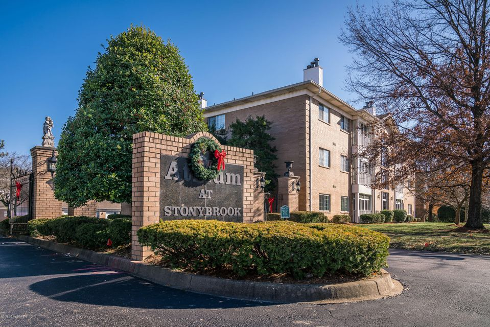 Welcome Home to The Atrium at Stonybrook ~  Spacious Condo that offers an OPEN FLOOR PLAN w/Over 1400 Sq Ft that features an ENCLOSED Balcony with a SCENIC VIEW of Mature Trees & Creek ~ Large Foyer greets You and Your Guest as you Enter to the Living Room that opens to the Kitchen & Dining Area ~ Kitchen features an Abundance of White Cabinetry, Breakfast Bar w/Appliances to Remain ~ Dining Area is Spacious for Large Furniture ~ Living Room features a Cozy Fireplace w/Built-In Shelving leading to the Enclosed Balcony w/Extra Storage Closet ~ Master Suite offers 2 Walk-In Closets, Private Full Bath & Door leading to the Balcony ~ Laundry Area w/Washer & Dryer to Remain ~ Bedroom 2 features a Walk-In Closet ~ Underground Parking & Plenty of Parking for Guests ~ Secure Building w/ELEVATOR ~