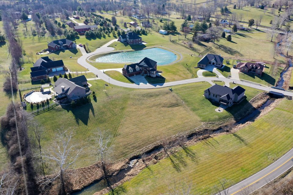 Last chance to be a part of The Estates of Richwood! Perfect spot to build your dream home complete with a desirable walk-out lower level and views of the running creek below. Enjoy the close-knit community, 1.5 acre stocked fishing pond with paved walking trail, and LOW Boone Co. taxes!