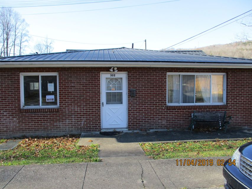 Ideal location in downtown Cumberland. This home offers three bedrooms and one and one half baths on a corner lot. Park is located across street. Home offers a spacious living/dining area, kitchen, with pantry area and additional sink.