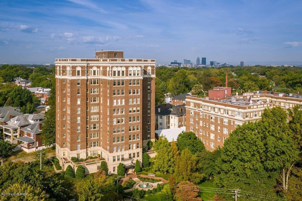 Welcome to Louisville's Historic Dartmouth Condominium Building. 1920s elegance updated for today's living. The Dartmouth has an attached Valet Parking Garage, Elevator, Stylish Lobby and beautiful views of Cherokee Park and surrounding Cherokee Triangle homes. 6B is in move in condition, ready for Immediate Occupancy and has Additional Garage Space for separate purchase. Large rooms, tall ceilings, inlaid hardwood floors and lovely architectural details. It has 2 bedrooms, 2 full baths, a living room, a dining room, and a family room. The remodeled kitchen is open to the breakfast room and to the family room. Pantry closet and 3 original pantry cupboards in the breakfast room. Laundry in the unit has side by side washer and dryer.