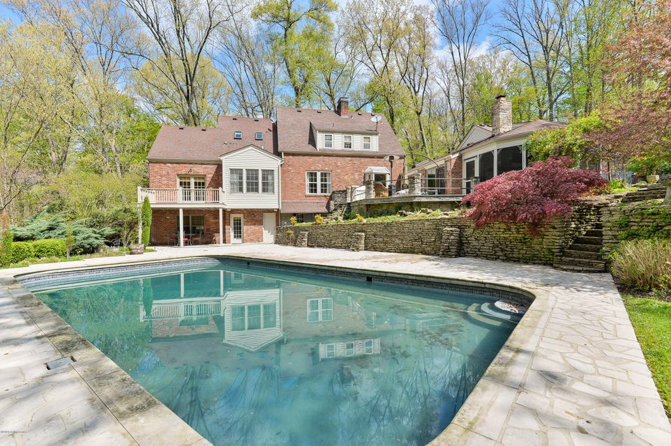 Situated in a private parklike setting with nearly 5 acres of incredible forestland, this country estate home features the ambiance of luxurious mountainside getaway, while still offering the convenience of an in-town retreat, just minutes from the restaurants, businesses and expressways of Brownsboro Road. Nestled among towering mature trees,...