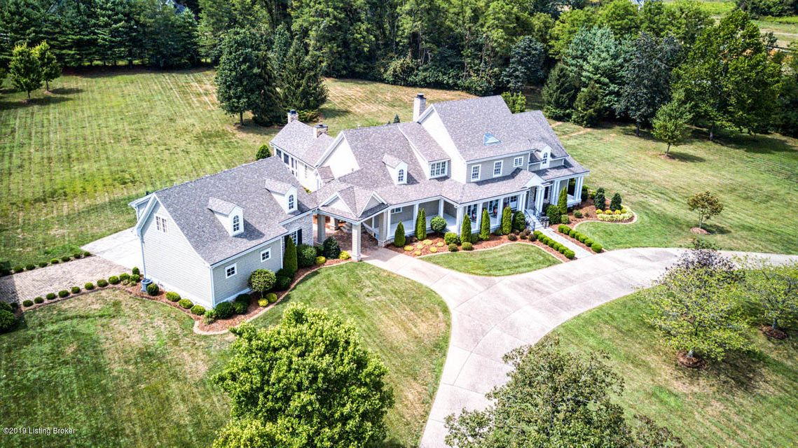 This gorgeous Estate home is situated on approximately 4.9 acres of picturesque beauty and reminiscent of the beautiful seaside shingled homes of Nantucket. Located just minutes from shopping, abundance of restaurants and easy access to downtown in 20 minutes. As you enter the drive the home will capture your heart with its warmth. The solid mahogany entry is massive and lends itself to all the detailed mill work. The custom design of this home is truly unique and inviting with many areas to enjoy and entertain in.There are 5 bedrooms and 4.5 baths in over 8200 square feet of living space.