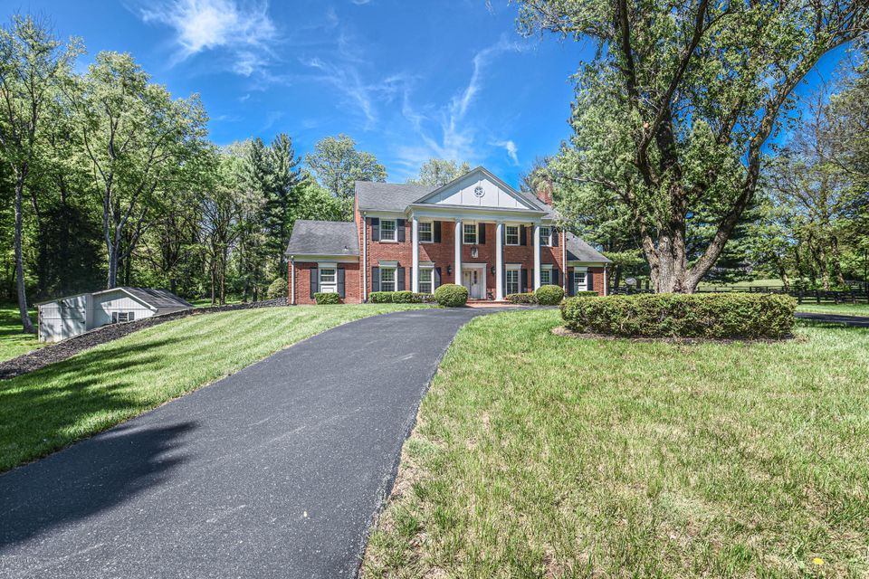 When you first travel down this winding drive your anticipation might be overwhelming.  Behold! In front of you is this elegant brick home with a circle drive & stately columns.  Your first thought might be BEAUTIFUL SECLUSION!  You don't see it all yet, but you have approximately 13 acres with 2 fenced paddocks.  The back of the property...