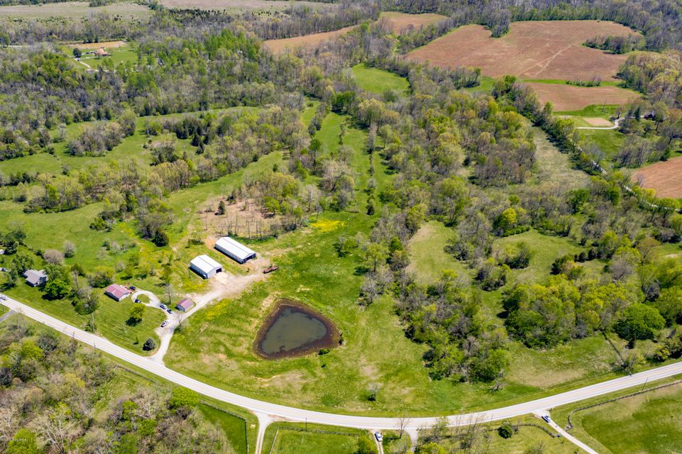 Great opportunity to purchase 52 Acres in Oldham county!!!!! This beautiful property feature a 3 bedroom, 2 bathroom Ranch home, a detached garage, and two Large Metal building ( approximately 42x62 and 40x100). conveniently located off of hwy 42 only minutes from I-71