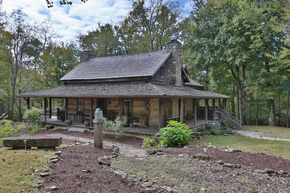 This unique property is a pleasure to show and a dream to own. This 1850's log cabin,was purchased in Central Kentucky and brought to Old Pond Place where it was rebuilt to create an incredible home with all the modern amenities. The attention to detail is unsurpassed. From the limestone foundation to the shake roof, to the wrap around porch...