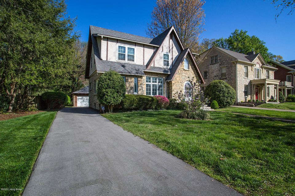 Positively charming English tudor nestled into sought-after location ''on the circle''. This home has been immaculately maintained, but offers an opportunity for your desired updates on a block where renovated homes can sell well above $750k. The unique original details are exquisite: intricately inlaid molding, arched doorways, 9' ceilings. A well-designed 1st floor guides you from the inviting foyer to formal living &  dining room...office, eat-in kitchen + half bath complete the main level. Upstairs features 3 large bedrooms & full bath w/ separate shower. The finished basement showcases family room with new carpet, brick fireplace, full bath, laundry area + storage. Outside, enjoy the 2.5 car garage & scenic yard that backs up to quiet, private lot. Just blocks from Cherokee Park!