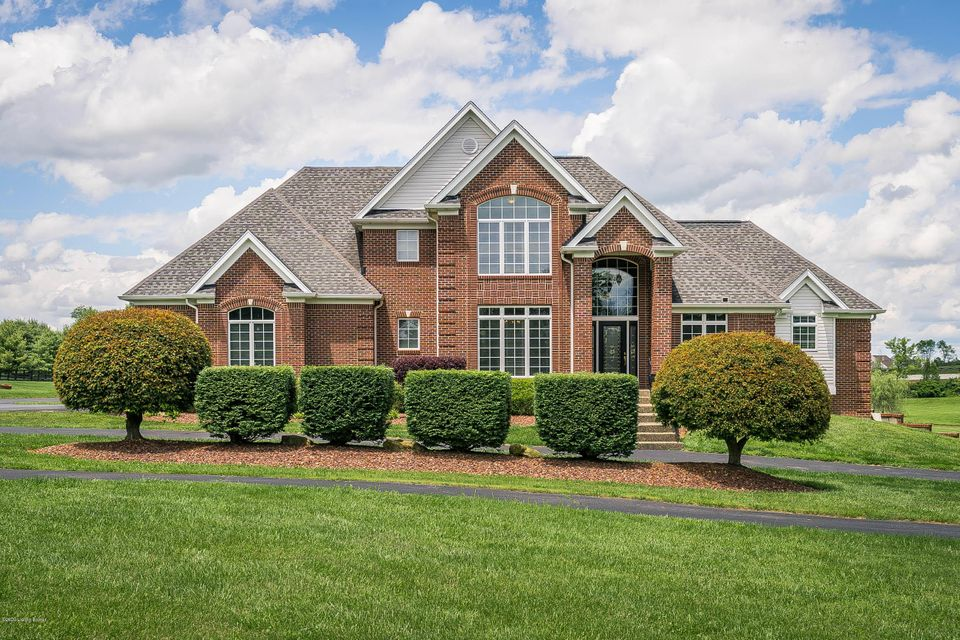 Beautiful estate home on over 7 acres with easy access to I64.  Offering a total of 5,508 sq ft, this like new home is neutral, clean & in move-in condition.  The 1st floor has a formal dining room & living room.  The large eat-in kitchen has an island with breakfast bar, white cabinets, & black and stainless appliances.  A butler's pantry is located between the kitchen & dining room.  The great room has a working fireplace.  The 1st floor master has bath with separate tub & walk-in shower and a large double vanity.  the 2nd flr has 3 bedrooms and 2 full baths.  The walkout basement offers great space for entertaining, fitness or play.  Two additional rooms & full bath in the basement.  This home also has a 3 bay attached garage & a 50 x 30 - 2 bay detached garage. Also, there is a nice