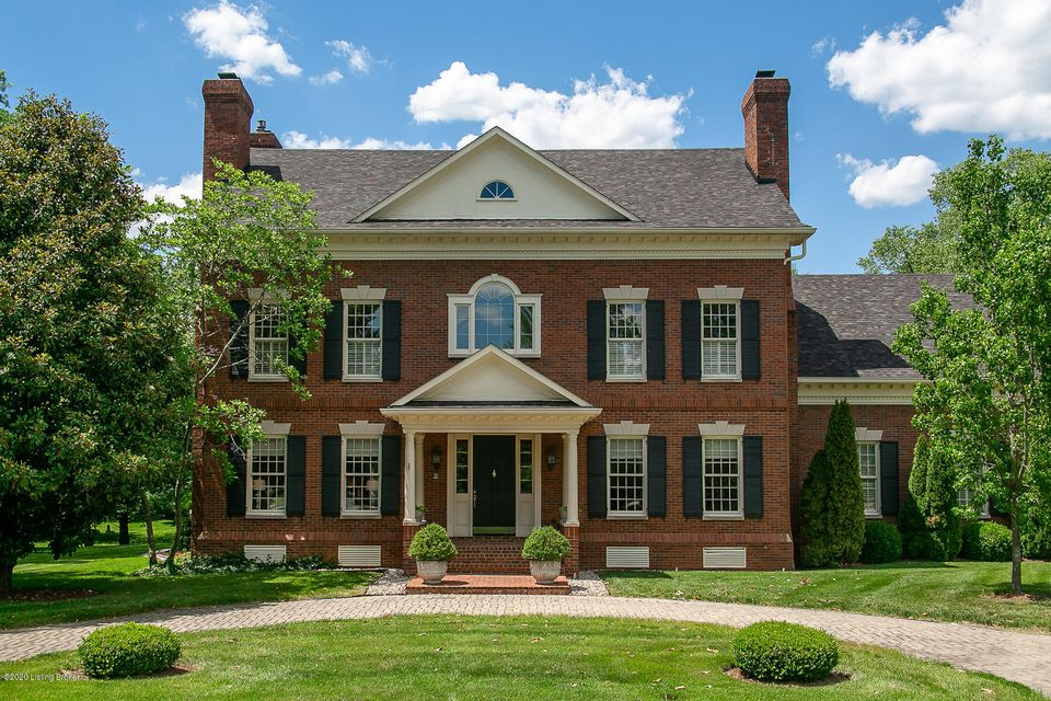 Situated in a private cul de sac, this stately home provides interior space that is just as impressive as the exterior. A proper foyer greets guest and is framed by the grand staircase. Upon entering, the formal dining room is on the right and a formal living room is on the left both complete with a fireplace. Intricate moldings and gorgeous hardwoods flow throughout the first floor. A designated office with a fireplace is in between the formal living room and family room. The cozy, log cabin family room has beautiful original details, a large gas burning fireplace and large windows that overlook the lush backyard. This family room is open to the eat-in-kitchen area providing ample space and an abundance of natural light.