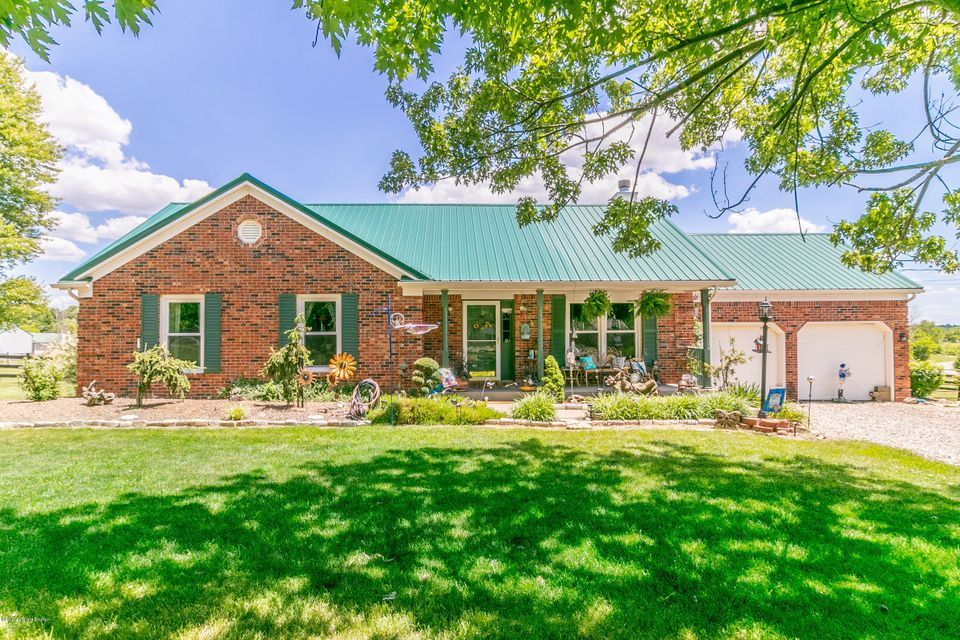 Fantastic all brick 3 bedroom ranch on almost 1.5 beautiful acres in LaGrange, move-in ready, needs nothing! Bring your swimsuits and jump right in! Inviting covered front porch to greet you, opens to vaulted Living Room - Dining Area - Kitchen with newer (2018) engineered hardwood flooring throughout, fireplace with distinctive glass tile hearth in Living Room, abundant cabinet and counter space in Kitchen (resurfaced cabinets,new counters and backsplash in '14). Recent makeovers to both full bathrooms including new flooring, vanities and toilets. Master bedroom features his and her closets (one's a walk-in) and laminate flooring.