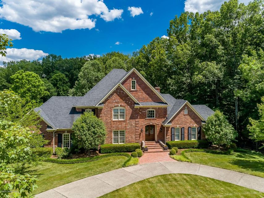 This stunning estate home sits on 4.6 beautifully wooded acres minutes from I265. This is a wonderful place to spend time at home! It features a chef's kitchen with walk-in pantry, multiple gathering spaces, a media room, a gym, an office, a spectacular billiards room with a wine cellar, a game room, a workshop, a very private backyard with...
