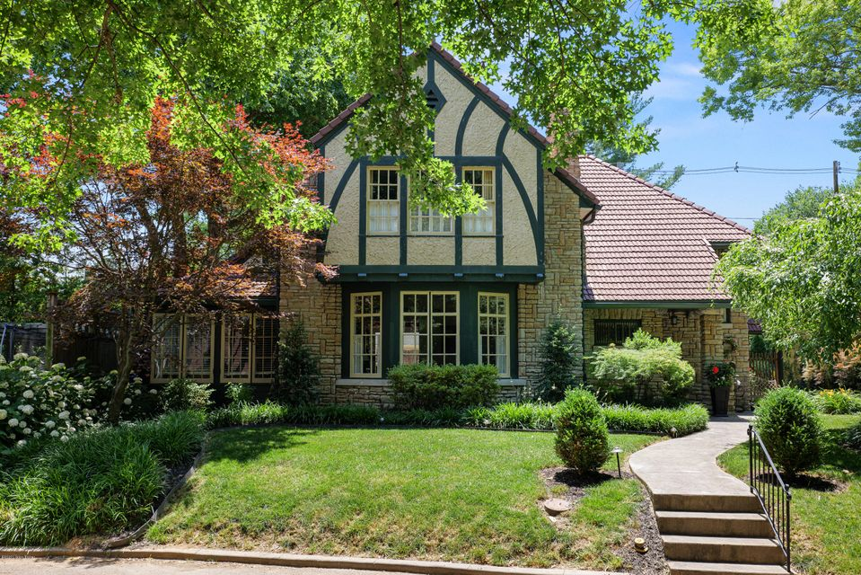 Parkside Stone and Stucco Charmer in move in ready condition has a magical yard with outdoor gas fireplace. You will love the 1920s Tudor charm when you step in the door. Spacious light filled living room has a fireplace, wood floors, large bay window and floor to ceiling bookshelves. The wide living room doorways open to the family room/sun...