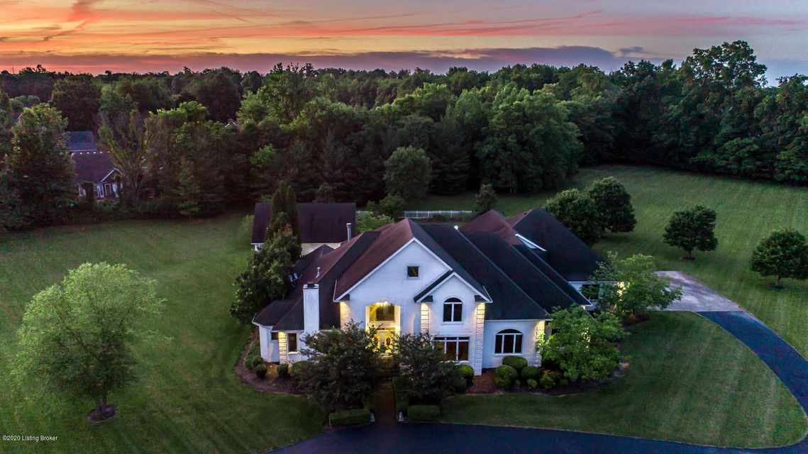 Welcome to 11318 Bodley Dr... Located in NUTWOOD Subdivision! Stunning Estate on 5.01 acres completely fenced with security gate at end of cul de sac. Home features 5,600 sq. ft. split floor plan, a pool house, and a barn with full utilities. Drive on up circular drive and come on in through glass front double doors. Upon entry of large 2 story foyer you'll appreciate all the natural light from floor to ceiling windows throughout. A formal living room, powder room, and library are also accessible from the entry hall. The living room has beautiful hardwood floors, fireplace, large windows which leads you to the gourmet eat-in kitchen featuring access to back patio, bar height counter to sit, tile, double oven, gas cook top, large pantry and butlers pantry leading to spacious dining room.