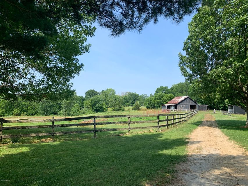 Don't miss this chance to own your own slice of heaven just minutes from Interstate 64 in Simpsonville. Here you'll find this peaceful mini farm, including a pond and 2 barns with 1 large 3 small stalls. This farm is suitable for grazing animals such as horses, cattle and goats.  The house needs remodeling and is being sold ''as-is'' with plenty of potential! The creekstone exterior is super unique which matches the homes focal point, the interior fireplace.  3 bedrooms (potentially 4) 3 full baths and an unfinished basement. The possibilities are endless.