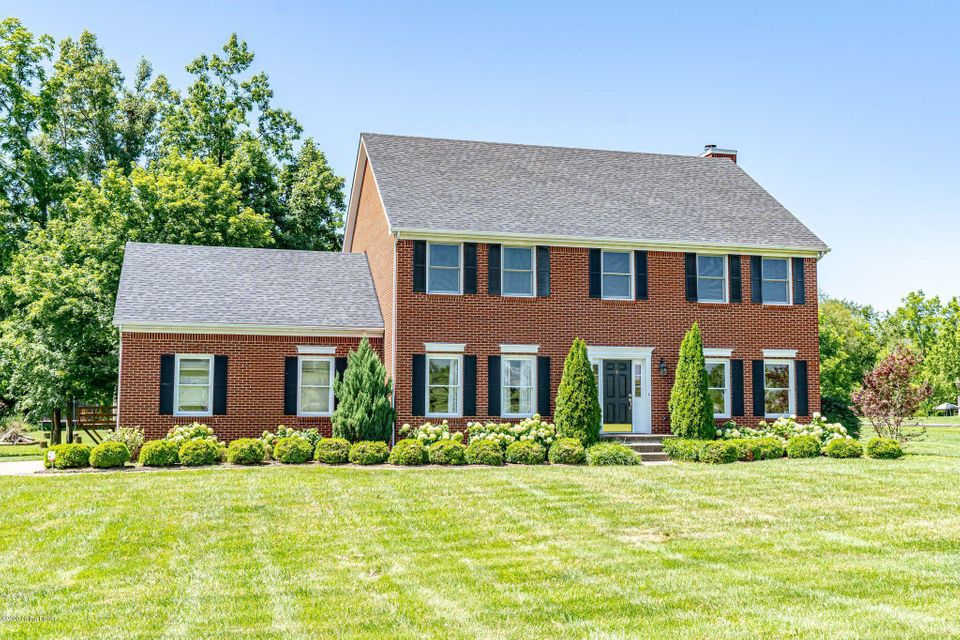 REDUCED $15,000!  Simpsonville's finest road.  Sitting among million dollar properties this traditional brick 2 story sits perfectly on this 1.87 ACRE lot.  Just the right amount of land for privacy but doesn't have you spending your whole weekend mowing.  Scattered shade trees in the back and not a close house within sight.  The back yard with this amazing patio & fireplace is so inviting from inside or outside this home.  As you enter it feels like a home well loved. Lots of crown molding & 9 ft ceilings.  Formal Living Rm / Dining Rm or office.  Lovely eat-in Kitchen, Family Rm is open to patio and eating area.  Large pantry and nice size laundry rm.  1/2 bath & 2 car garage all on main level.  Upstairs you will find a large Master, roomy walk-in closet and lovely MBA.  3 additional
