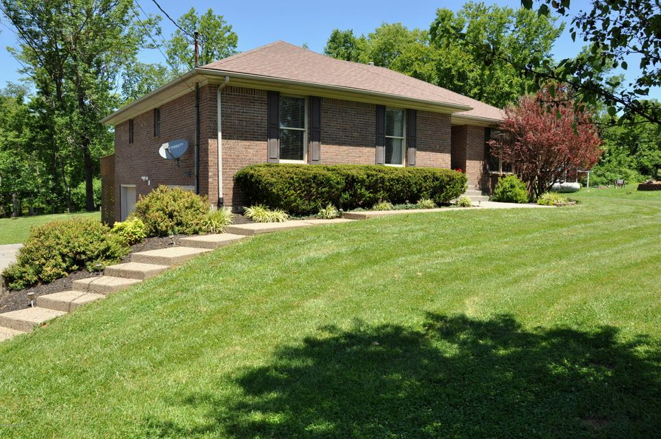 Take a look at this gem! 3BR/2BA brick ranch home with one owner, located in the desirable Walnut Hills subdivision. Amazing lot at the end of the cul-de-sac! The main level of this home features great room with gas fireplace, kitchen with lots of cabinet space, casual dining area, formal dinning room, large master bedroom with master bath, two additional bedrooms, and a full bath complete the main level of this home. The lower level features family room, office, laundry room,  a large storage room (could be finished for additional space), and a lower level two car garage. The large back deck and beautiful country views make this home perfect for entertaining and enjoying the outdoors. This home is a MUST see and very convenient location only minutes to I-71. Call for your private showing.