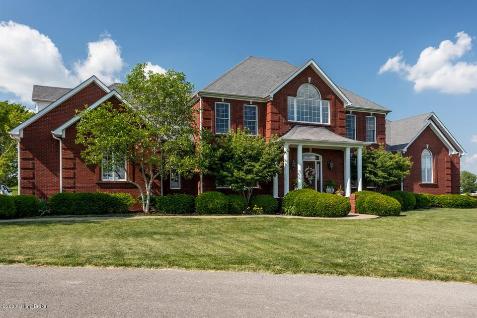 Cover-of-a-magazine-worthy, this sophisticated one-owner Kentucky property is a rare find. Enjoy both tranquility and convenience on this 12-acre luxury estate -- with sprawling farms views, and VERY MINIMAL drive time to downtown (Centre College, Ephraim McDowell Regional Medial Center) or the 127 bypass. The impeccably-thought-out custom floor plan boasts a MASSIVE private FIRST-FLOOR MASTER SUITE with ATTACHED LAUNDRY, formal dining/living rooms, a gourmet kitchen with stainless steel appliances / gold-flaked granite countertops, regal double archways, breathtaking 10' and CATHEDRAL CEILINGS, open landings, elaborate chandeliers and majestic multi-piece crown molding accents. The oversized TRANSOM WINDOWS let in tons of natural light and flaunt the EPIC VIEWS.
