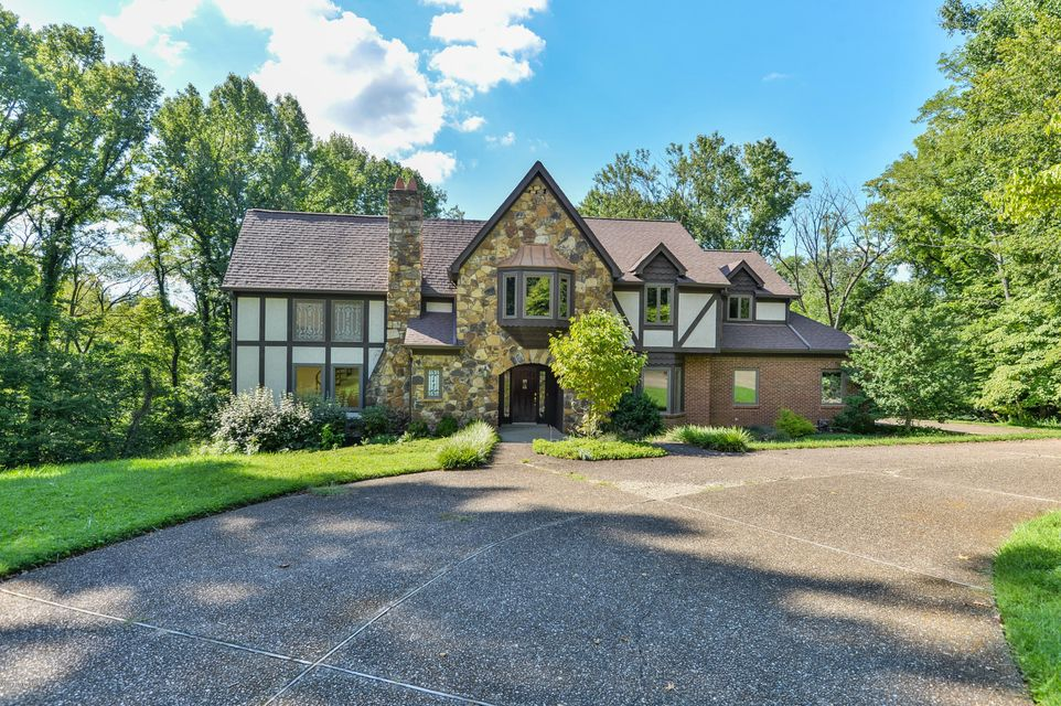 This beautiful walk-out English Tudor style home as been lovingly cared for by it's current owner for the past 27 years.  You will not find window treatments here for they would only obstruct the breathtaking views of this rare 2 acre parcel and private park-like setting. Many desirable features will be found on the first floor inculding a...
