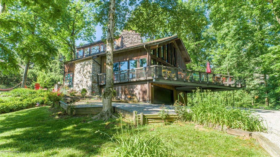 **Priced well below recent appraisal!** This cool contemporary home is tucked away on a wooded lot of just under an acre in highly desirable Mockingbird Valley. A European flair, an eye for design, and attention to detail are obvious in the renovations of this home. Upon entry, you are welcomed into the massive great room wrapped in glass,...
