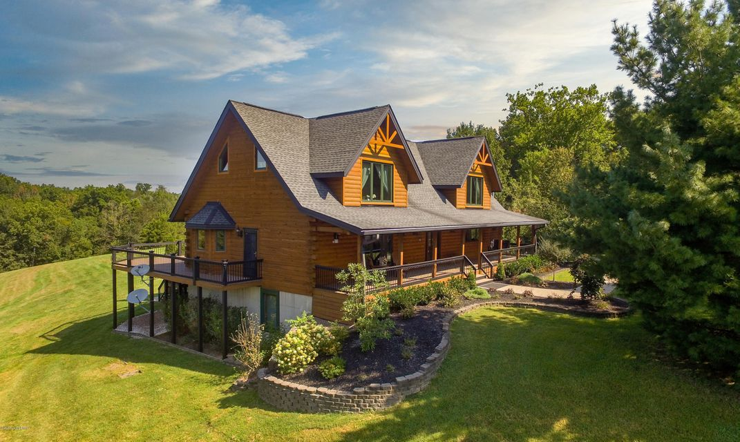 This CUSTOM LOG HOME located in the tranquil rolling hills of Shelby County has just been listed and is available for your private showing! This is a beautiful, one of a kind, custom Kiln-dried log home with 4 bedrooms & 3 1/2 baths. Situated on 10.1 acres, the home is nestled on an open area that is surrounded by trees and greenery for privacy....