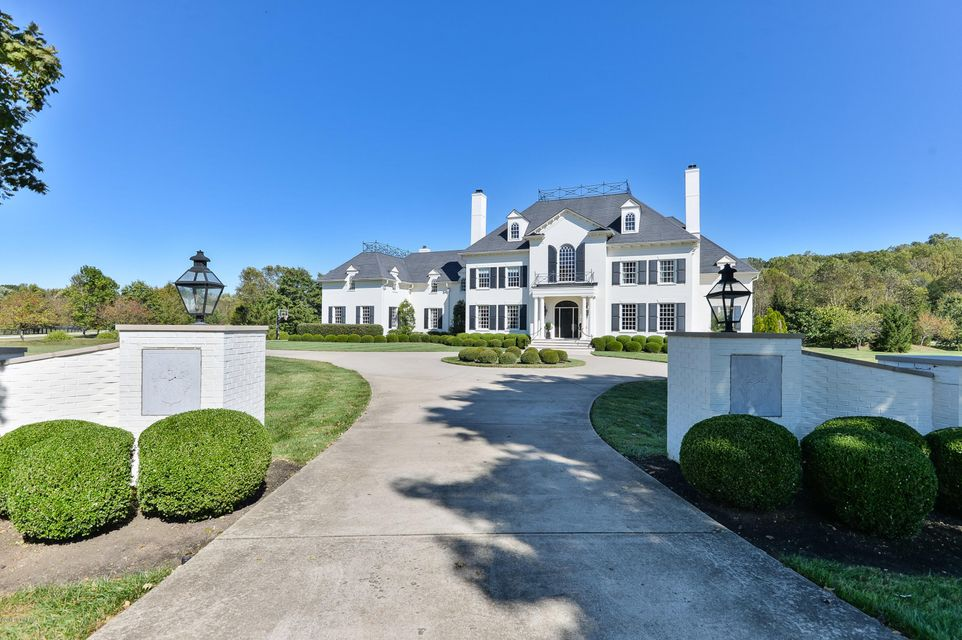 Perfectly situated on just over 3 acres in Oldham county, this timeless masterpiece was beautifully built in 2007. Upon entrance you'll find architectural detail throughout; mahogany hardwood flooring, custom built staircase, crystal hardware, ornate mantels with European influence, detailed millwork and 12 ft. ceilings. While southern grandeur...